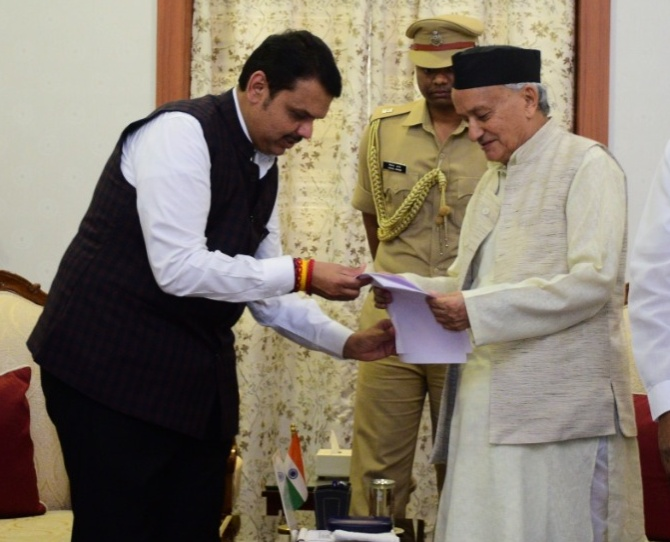 Devendra Fadnavis submits his resignation as Maharashtra chief minister to Governor Bhagat Singh Koshyari, November 26, 2019. Photograph: Arun Patil