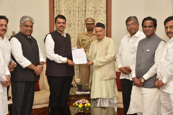 Devendra Fadnavis, accompanied by senior Bharatiya Janata Party leaders, submits his resignation as Maharashtra chief minister to Governor Bhagat Singh Koshyari. Photograph: Arun Patil