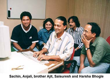 Harsha Bhogle with Sachin, Anjali and Ajit Tendulkar and Rediff's Saisuresh Sivaswamy at the keyboard when Sachin appeared on the Rediff Chat.